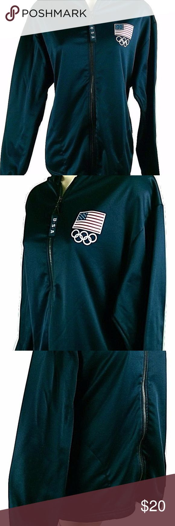 """US Olympic Committee Black Hooded Jacket This is a black polyester USA Olympics hooded jacket. Lightweight . Has the American flag on the top of the Olympic icon in front. The inside is a soft fleece-like material.Two front pockets and it zips up with a U.S.A. ribbon pull on the zipper. Size large. See the pics.  Measurements (lying flat):  Chest (across the front) - 21"""" Length - 26"""" Sleeve - 23"""" _______  * Comes from a clean, smoke-free, pet-free environment. * Color variations may occur…"""