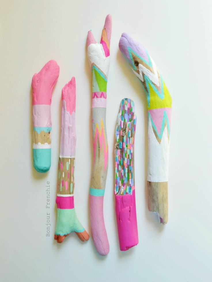 More beautiful painted driftwood from Jessica Turnbow, bonjourfrenchie on etsy. (Painted Driftwood, Neon Stick Collection 5 Piece - Home Decor, Prop, Centerpiece, Pastel, Stripes, Triangles, Tribal, Scallop, Painted Stick. 130 dollars, via Etsy.)