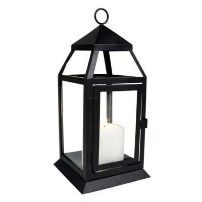 "23588 - Small Black Richmond Lantern - Wholesale. This small lantern is ideal for a mantel, small table, or countertop. A good size for a votive candle or small pillar candle. 3"" x 3"" pillar candle shown as an example (not included). Door has a 3 1/2"" x 5 1/2"" opening. Glass assembly..."