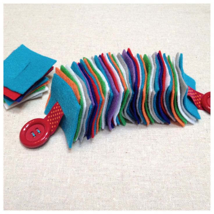 Felt Button Snake. My idea: Use different cloths with different textures for little hands to explore