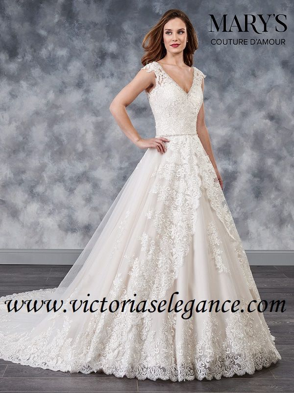 e3bcb83417 Tulle and lace applique wedding ball gown features beaded V-neck, cap  sleeves, beaded waist line, skirt overlay, back lace-up closure, and  cathedral train.
