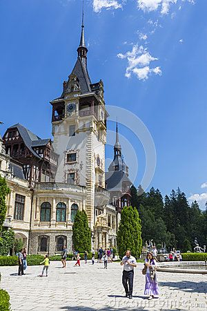 Unidentified tourists enjoy a visit at Peles castle on July 24, 2013 in Sinaia, Romania. Given its historical and artistic value, Peles castle is one of the most important and beautiful monuments in Europe.