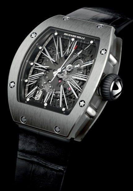 The Richard Mille RM023 measures 45 x 37.8 x 11.45mm, placing it between the RM007 and the RM010. Mille says this watch is designed for both men and women. The winding rotor offers variable geometry and it can be set to the owner's activity level before it leaves the manufacture. The weight segment along the rotor's outer edge is milled (no pun intended) from a special tungsten/cobalt alloy, and the rotor's ball bearings are created from synthetic ceramics.