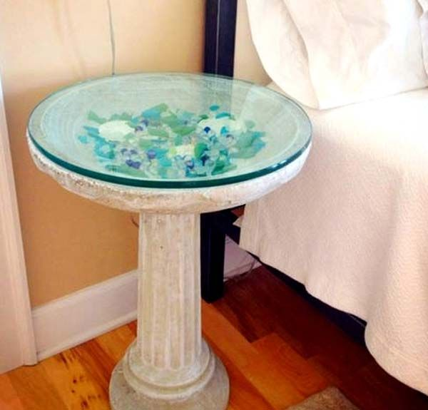 A bird bath table displays colorful seaglass:  24 Cute DIY Home Decor Ideas With Colored Glass and Sea Glass