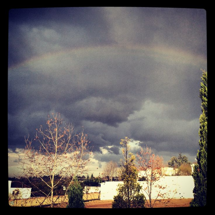 Grey clouds and a rainbow. Awesome.