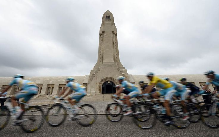 Italy's Vincenzo Nibali wearing the overall leader's yellow jersey and his Kazakhstan's Astana teammates ride past the Douaumont's boneyard (Ossuaire de Douaumont)