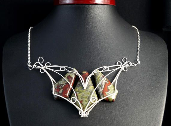 A unique, handmade, wire wrapped necklace with Bloodstone.  Pendant was designed and made by Me, using an extremely labor-intensive and precise wire-wrapping technique, with silver plated wire.  Dimensions of pendant: length: 5.5 cm 2.16 inch width: 12.5 cm 1.22 inch  You receive this unique pendant in jewelry box, so it is ready to be a gift.  ---On this auction You buy necklaces with silver chain ( 40 cm 15,74 inch).----   Refunds and Exchanges:  If you are not satisfied with your purchase…