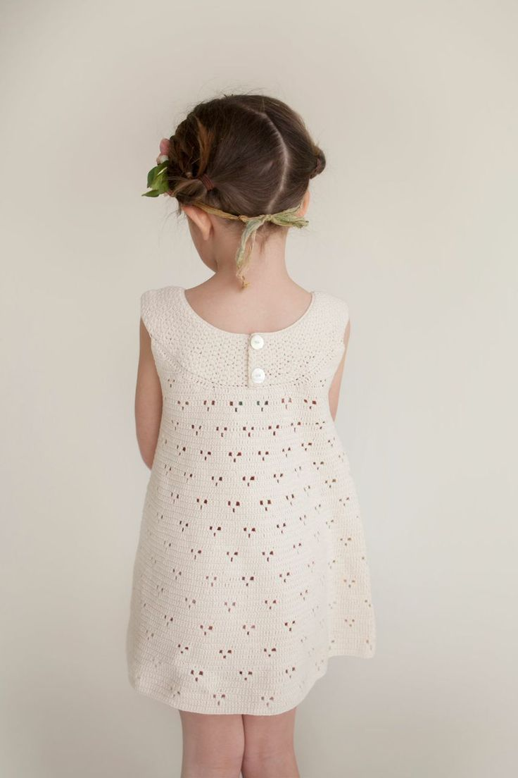 The Rebecca Dress in cream is hand-crocheted with eco-friendly raw organic cotton.