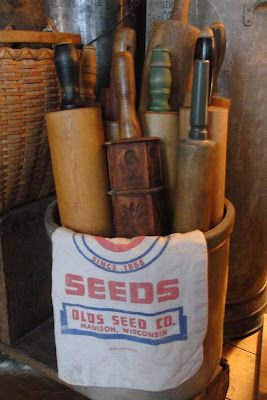 Old Crock...stuffed full of prim rolling pins & old seed sack.
