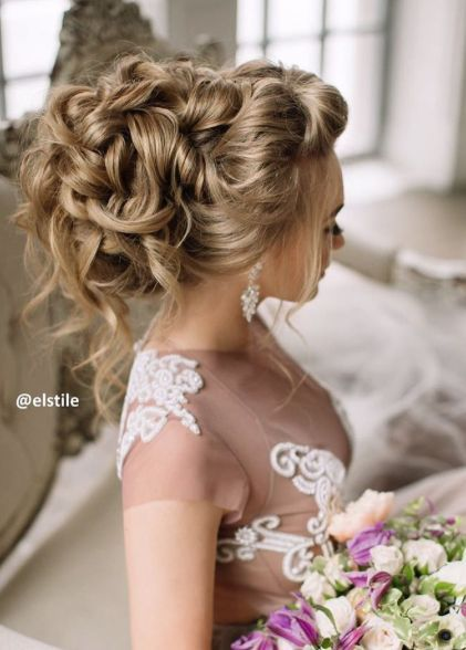 Sophisticated loose curly updo wedding hairstyle; Featured Hairstyle: ElStyle