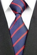 Stropdas Bristol - Blauw Rood Gestreept  Description: Stropdas Bristol Maak jouw outfit vandaag nog compleet met deze mooie deluxe stropdas. Deze stropdas heeft een mooie brede blauwe streep afgewisseld met een rode smalle streep. Door deze mooie kleurencombinatie krijgt je outfit meteen meer kleur en uitstraling. Of dat je nu een lichtblauw overhemd draagt of een wit de das kan prima gecombineerd worden. Het is fijner om meerdere stropdassen in je kast te hebben hangen zodat je af kunt…