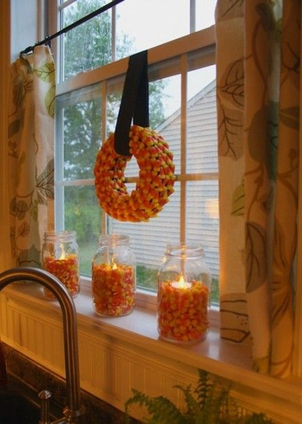 DIY Fall Decor Ideas... Love the mason jars w candy corn and candle :)