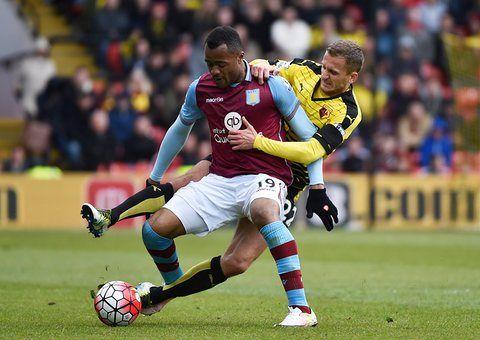Watford's Almen Abdi literally grapples with Aston Villa's Jordan Ayew
