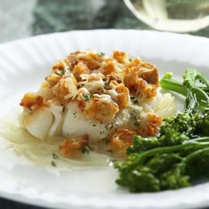 Dry white wine and Gruyère cheese give this fish casserole a rich