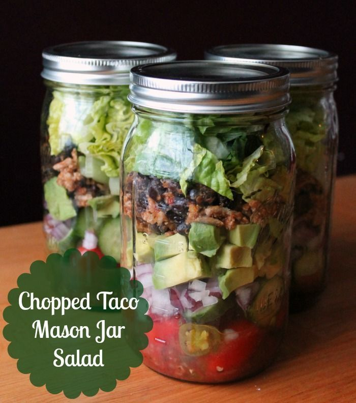 Chopped Taco Mason Jar Salad with taco seasoned ground turkey, black beans, salsa, plain Greek yogurt, cherry tomatoes, cucumbers, red onion, chopped avocados, lime juice, pickled jalapenos and romaine lettuce. Convenient, make ahead lunch option. #organizeyourselfskinny #masonjarsald