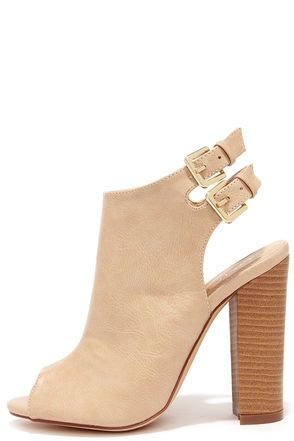 """You have every reason to flaunt the Bootie-licious Beige Peep Toe Booties, and their adorable day-to-night look! Crinkly vegan leather constructs a peep-toe upper with a cutaway heel, and two adjustable ankle straps with gold buckles. 4.25"""" wood-look block heel adds a nice contrast in tan. Cushioned insole. Rubber sole has nonskid markings. Available in whole and half sizes. Measurements are for a size 6. All vegan friendly, man made materials. Imported."""