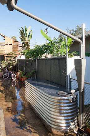 To reduce water use, architect Isabelle Duvivier's Venice house has two cisterns that can hold 800 gallons of rainwater. One cistern waters fruit trees. The other supplies a fish habitat and irrigates the cut-flower garden.