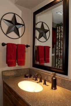 Maybe add an iron artwork piece in the bathroom. Also like the pop of red against the gold & brown