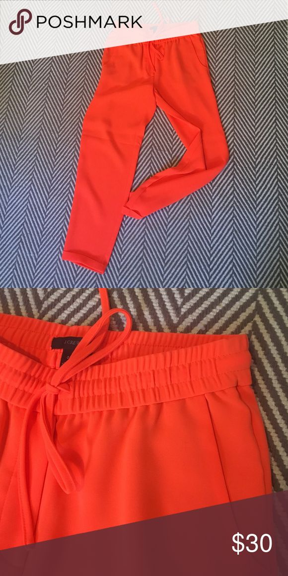 J.Crew Drapey Silk Pants A super spicy neon orange, perfect for summer time! Drapey fit, elastic band waist with drawstring & cuffed hem at the bottom. Cropped. Only worn once! J. Crew Pants Ankle & Cropped