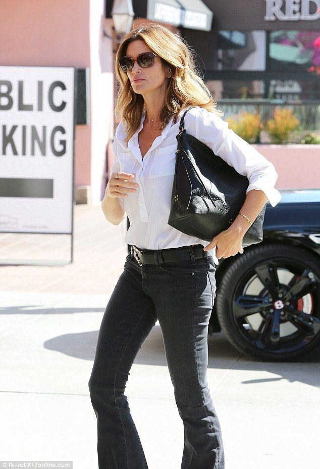 Understated chic! The supermodel sported a white blouse tucked into dark bootleg jeans