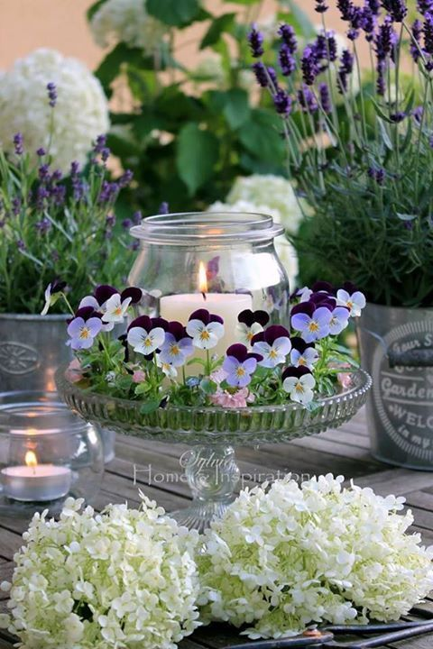 Use pansies and plant them weeks ahead of the wedding. Add the candle last minute for a great centerpiece. If the plants are growing, you just have to keep them watered to have them look great on the wedding day.: