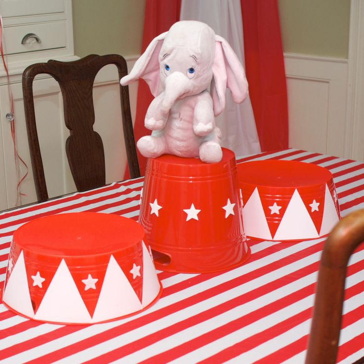 Circus Pedestals created by using red plastic tubs from Dollar Tree and adding white cardstock triangles and star stickers. ---Dumbo Circus Train Party