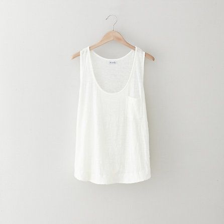 A white tank top is also a staple. I keep several varieties of these around because they just look so darn good with ANYTHING!