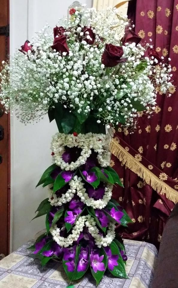 A traditional floral arrangement in a Malay wedding.