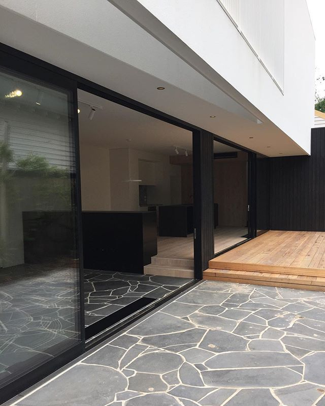 Couldn't help but post another of our #mainstreet Northcote house. Bluestone crazy paving runs both inside and out.  The first floor screen peels away from glazing line to give glimpses of the level below and filtered views to its neighbours. Well done #lewbuilding !  #nixontullochfortey #melbournearchitecture #australianarchitecture #crazypaving #screening