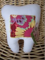 Perfect spot for your kids tooth. They won't get lost and will be ready for the toothfairy!