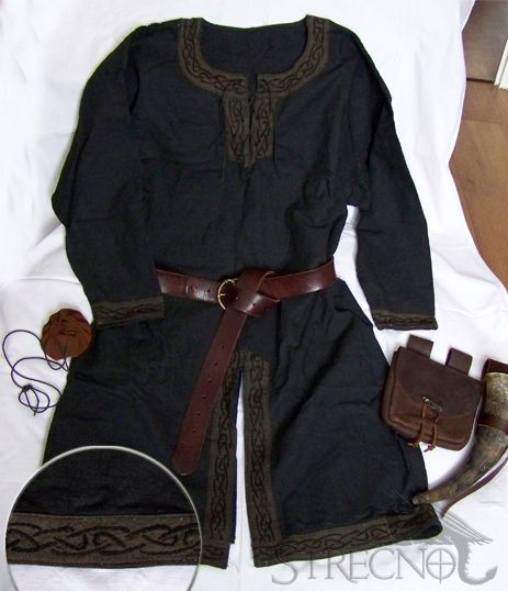 Dark gray, almost black tunic.  Long sleeves, mid thigh to hemline.  Split up the front for walking.  Trimmed on all edges (collar, front, wrist, front and rear split.