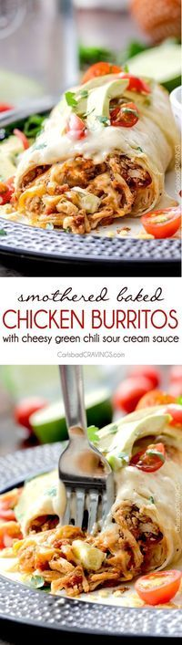 """Smothered Baked Chicken Burritos AKA """"skinny chimichangas"""" are restaurant delicious without all the calories! made super easy by stuffing with the BEST slow cooker Mexican chicken and then baked to golden perfection and smothered in most incredible cheesy green chili sour cream sauce."""