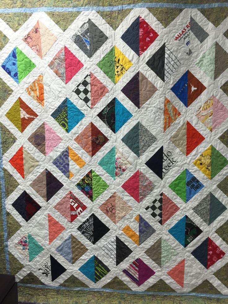 Memory quilt made with clothing from a young Mom.