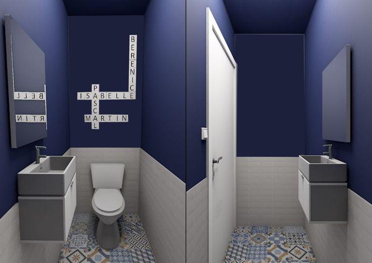 On ose le total look bleu dans ses WC en peignant les murs et le plafond pour un effet cocon! On garde un soubassement en carrelage type métro blanc et on recouvre le sol de carreaux ciment patchwork. Au mur pour une déco sympa on se créé en lettre de scrabble une composition avec les prénoms des habitants de la maison : ici en carrelage.