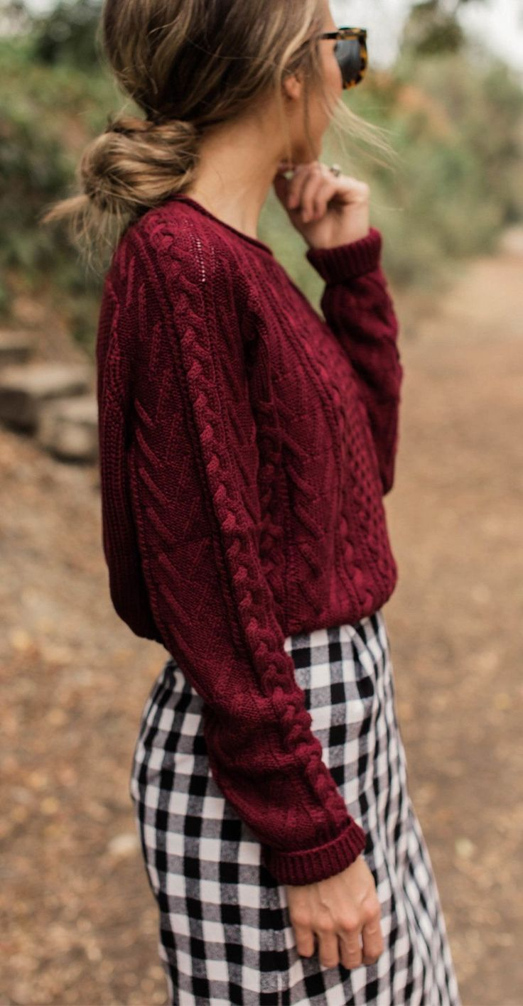 Cute burgundy sweater with black and white checked mini skirt.
