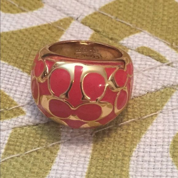 Coach ring Gently used. Color appears to be orange with gold tones. Really pretty. Unsure of size. Would guess it to be a 6 to 6.5 Coach Accessories
