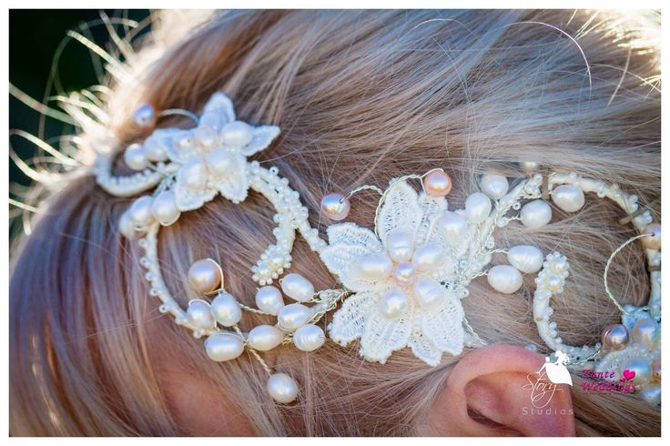 A stunning lace and pearl hair accessory for a perfect bride