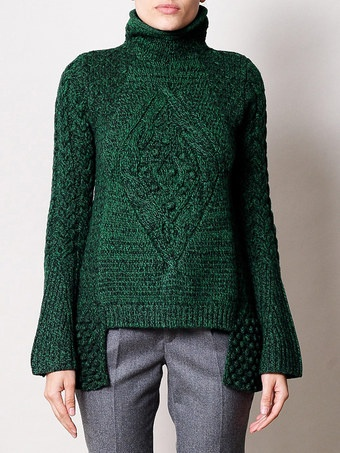 Asymmetrical Aran Sweater Makes me question how I feel about bobbles.