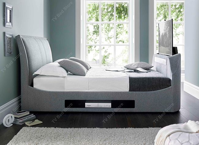 The Maximus King Size TV Bed Made by Kaydian Design this Luxurious Multi Media TV Bed is definitely one of a kind. Its fantastic features and looks makes this is the most advanced TV Bed on the market to date. It's 8 3d sound speakers housed in the foot end and the sub woofer work together to create the clearest surround sound effect from the comfort of your own bed. Features 3d Surround Sound High Definition Sound bar Sub Woofer 8 Built in Speakers Integrated remote control for easy adjust