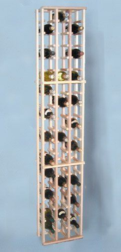 """Country Pine Three Column Wine Bottle Rack - Holds 66 Bottles by KegWorks. $99.95. Holds up to 63 bottles plus 3 bottles stored on top.. Country Pine is sought after for its rustic look.. Soft creamy color combined with subtle streaks and small knot patterns.. Made from a knotty grade of wood.. Dimensions: 13 1/2""""W x 72""""H x 8 3/4""""D.. It is likely that those who love wine, have seen this luxurious style racking at fine restaurants and winery's across the country...."""