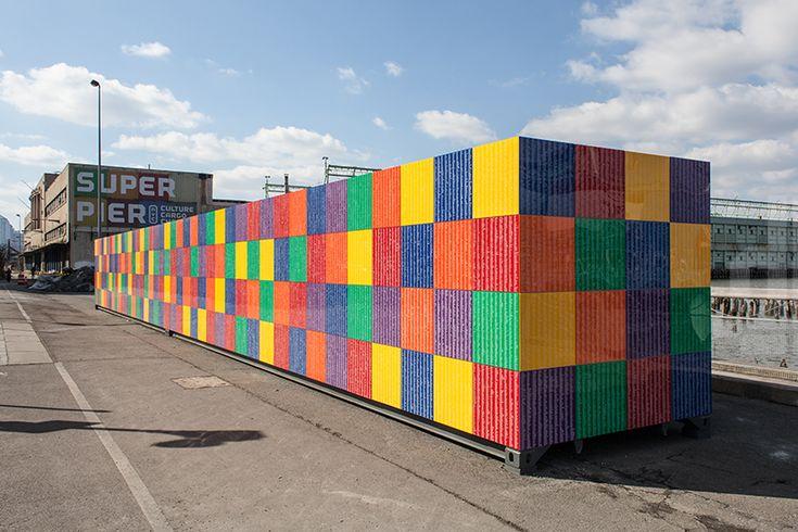 tony tasset carves 392,486 artists' names onto multicolored monument