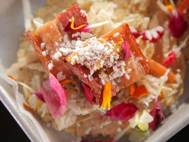 This former fast-food joint dances with vibrant colors and serves bright, beautiful dishes to match. Chef-Owner David Vargas channels the traditional tastes of Mexico, but delivers them in slightly tweaked formats. His pork belly tacos are a popular pick. Housemade tortillas are layered with jicama slaw and crisp slabs of spice-laden pork belly, then topped with mango salsa, Cotija cheese and a flurry of fresh flower petals.