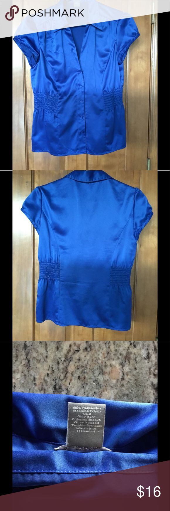 Ann Taylor Blouse Beautiful royal blue 5 front button with collar and smocking at waist sides. Cap sleeves. Would go well black or neutral colored business suit, or would look equally great with jeans. Excellent used condition. Ann Taylor Tops Blouses