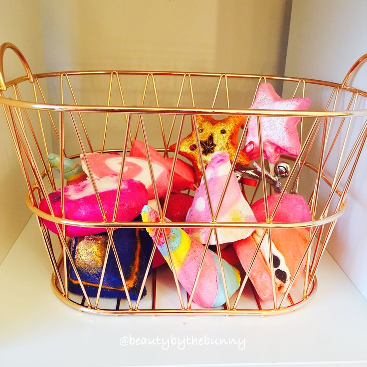 Basket of Lush bubble bars// the storage container// unicorn horn, comforter, peeping santa, candy mountain, revamped Karma, magic wand, magic of Christmas (just ones I can see