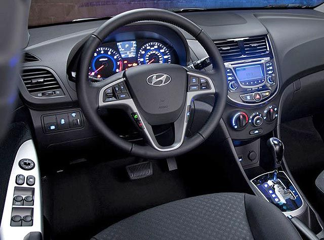 New Hyundai Accent 2013: Modern Efficient Car Under $15000 (Interior - Cab - Steering Wheel - Dashboard - Panels - Driver Seat)