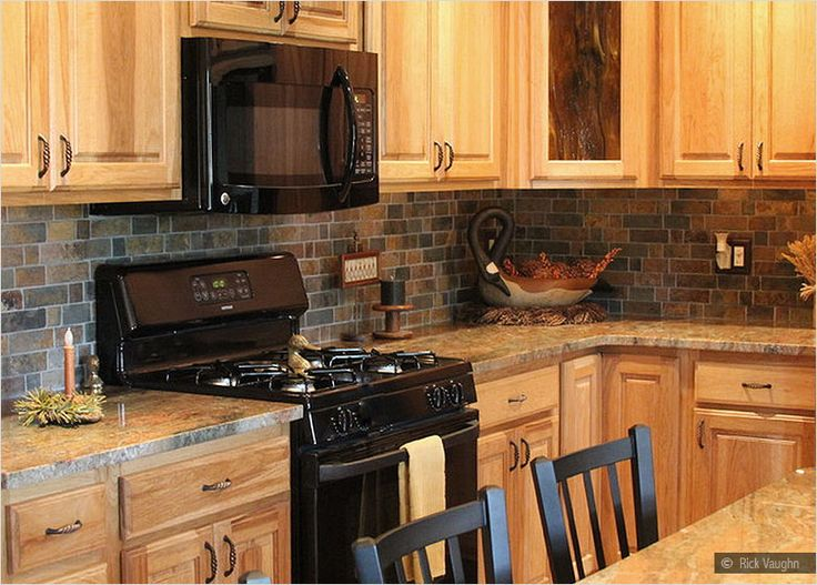 oak kitchen cabinets slate backsplash tile granite countertop oak