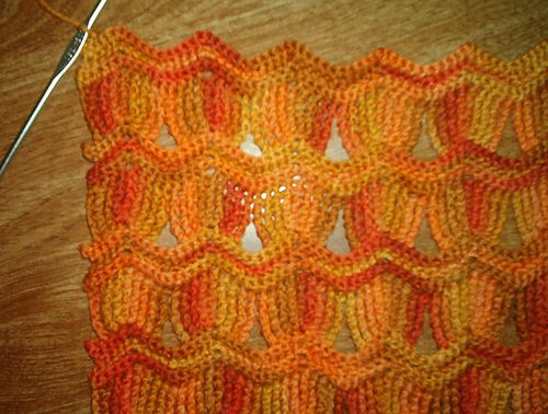 This pattern came about as a result of this thread, which I figured out from the photo linked in the first post. It would make a great afghan in DK-or-heavier yarn, and this sample that I'm working up in fingering is going to be a nice scarf. Done widthways, it'd be a nice stole.