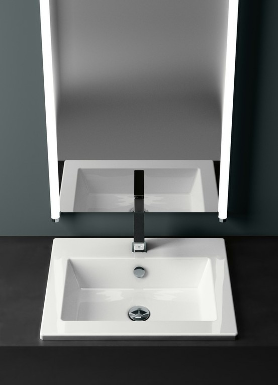 GSI ceramic | KUBE 58/I washbasin is designed for inset fitting on a cabinet or surface. Once installed the basin will be fully integrated and has a thickness of only 2 cm.