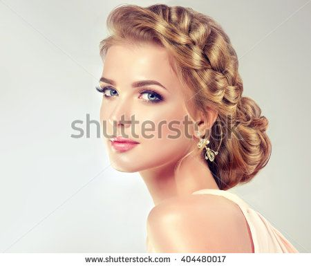 Beautiful model girl  with elegant hairstyle . Woman with fashion wedding hair .