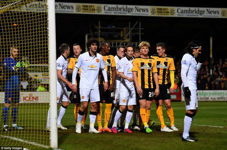 Jan.23rd. 2015: Cambridge United load the six-yard box around Manchester United goalkeeper David de Gea for a corner in the 4th. round FA Cup tie. Great result for Cambridge United, replay at Old Trafford to come. If you're hoping MUFC win at home order your kit at www.soccerbox.com using coupon MEGA15P (before 31/01/2015) to get 15% off and show you are a true Red Devil!
